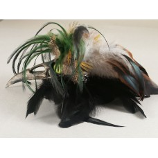 Raven beak fascinator with green tone feather trim